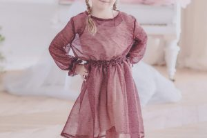 smiling-pretty-barefoot-girl-in-festive-dress-AXXWKNG-scaled.jpg